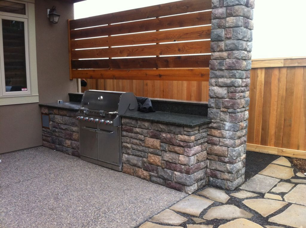 outdoor kitchen with cedar backboard